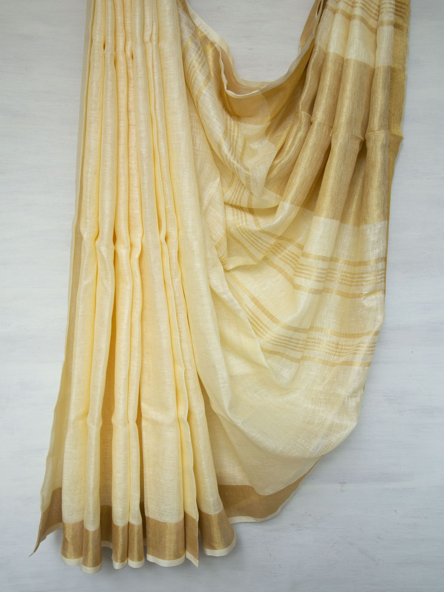 Cream with Gold Zari Linen Saree